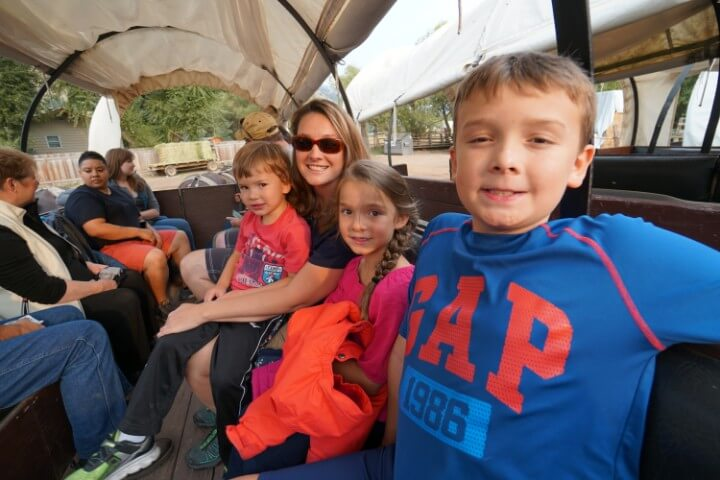 Kids and mom on a covered wagon