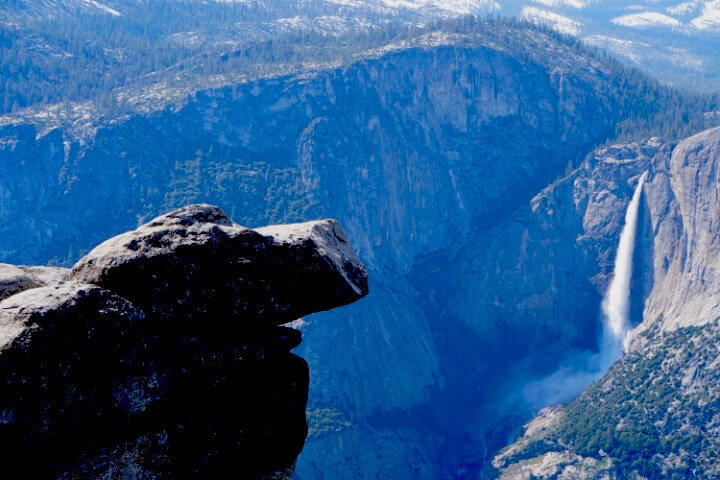 A View of the Yosemite Falls and rock formations at Glacier Point located in Yosemite National Park