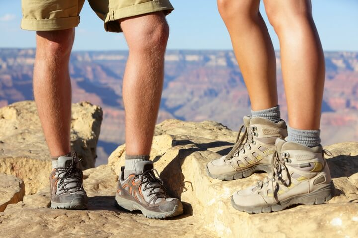 Two people in hiking shoes at Grand Canyon