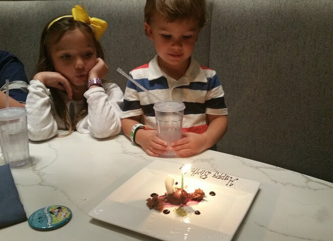 Image of Boy Blowing out Birthday Candles